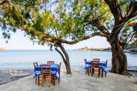 Apokoftos: Tables of a local eatery, overlooking the sea