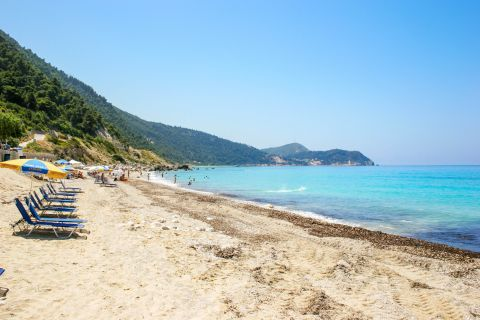 Pefkoulia is an impressive large sandy beach.