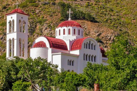 Aperi: A beautiful church with red colored ceramic roof tiles.