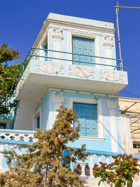 Menetes: An old mansion with white and blue colors.