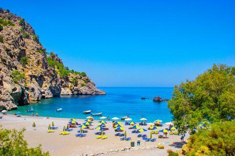 Achata: Some umbrellas and sun loungers. Achata beach.