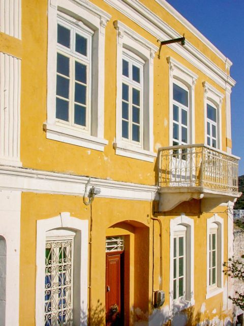 Platanos: A colorful mansion.