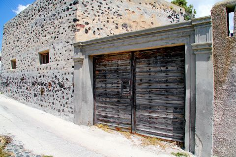 Megalochori: A traditional stonebuilt house with a wooden door