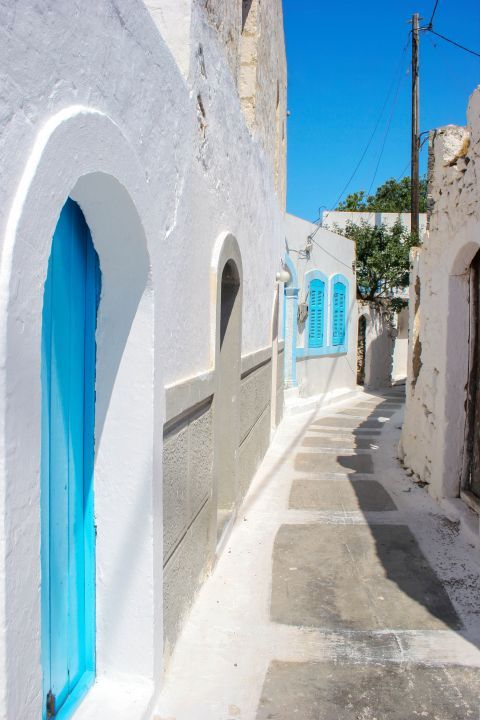 Emporios: Whitewashed houses with blue colored details.