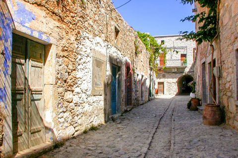Olympi: A picturesque alley with stone-built houses.