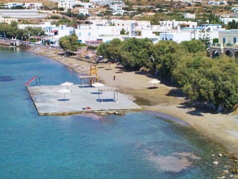 Finikas: Trees and whitewashed houses are spotted by the beach