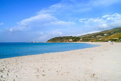Messakti: Sandy beach with blue waters.