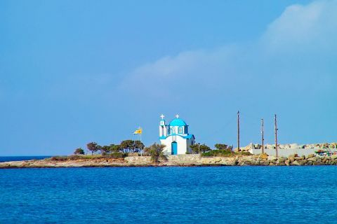 Messakti: A white and blue colored chapel, overlooking the sea.