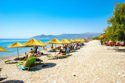 Pythagorio beach: Pythagorio is fully organized with straw umbrellas and sundecks.