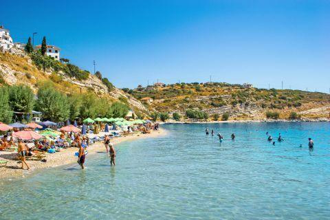 Pythagorio beach: Trees and natural landscape surround Pythagorio beach.