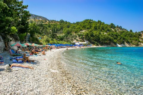 Lemonakia: The turquoise waters create an exotic scenery surrounded by high cliffs with vast vegetation.