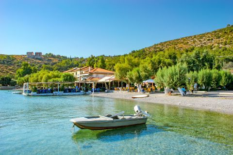 Posidonio: Posidonio beach is rather a small and calm cove with green crystal clear waters.