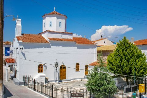 Megalochori: A beautiful, white-colored church with ceramic roof tiles.