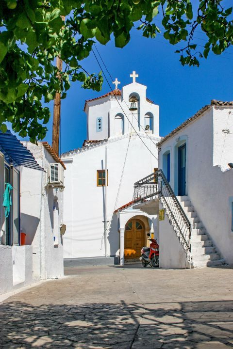 Megalochori: A picturesque alley that leads to an imposing, whitewashed church.
