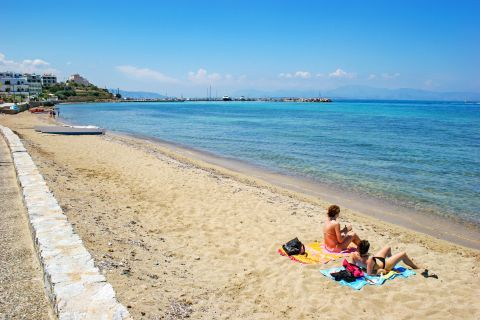 Megalochori: Relaxing moments on the soft sand of Megalochori beach.