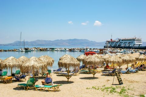 Skala beach: Nearby there is a small port.