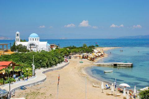 Skala beach: The church of Agioi Anargyroi is located next to the beach of Skala.