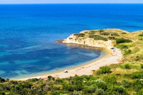 Platania: Platania beach is urrounded by lush green vegetation.