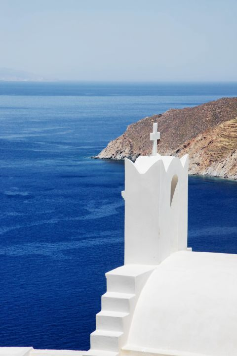 Potamos: A whitewashed chapel overlooking the sea
