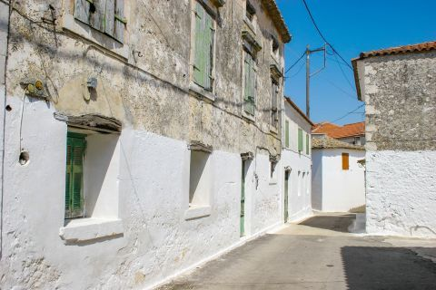 Agios Leon: Two floored houses with green colored shutters.
