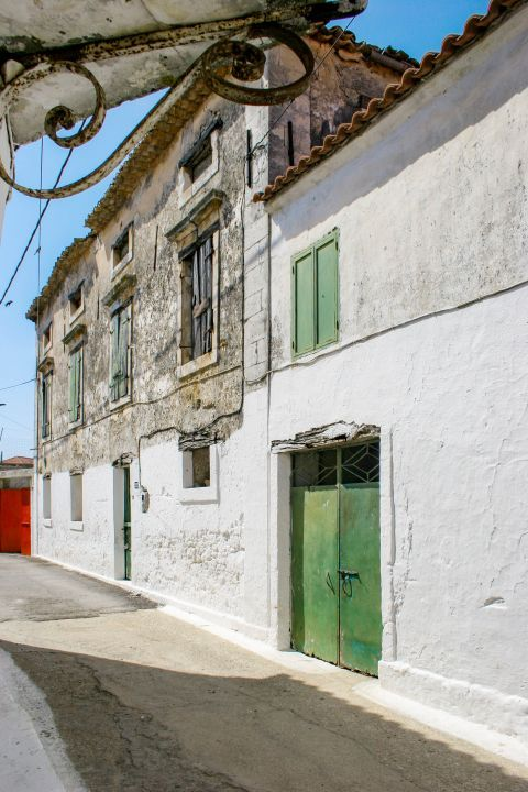 Agios Leon: An old building with colorful details.