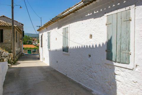 Agios Leon: A light-colored building.