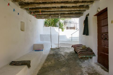 Agios Leon: A cozy spot outside a local house.