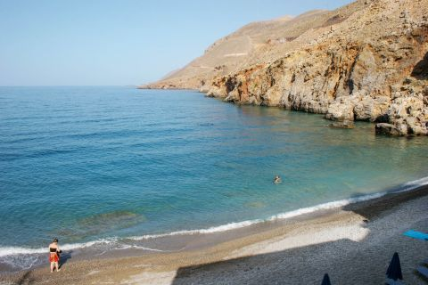 Sfakia beach: Pebbled beach with cliffs and blue waters