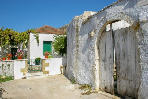 Gavalochori: A local house with colorful doors and windows and beautiful flowers