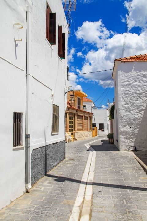 Genadi: A narrow path with picturesque houses.