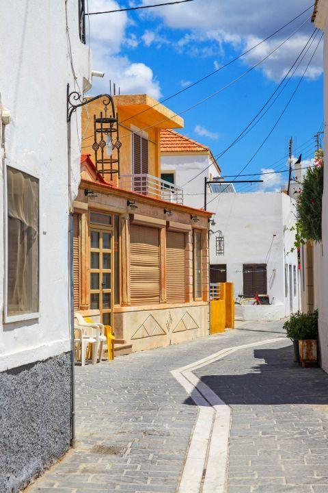 Genadi: Beautiful houses, painted in pale colors.