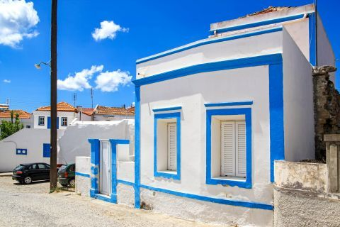Genadi: A whitewashed house with blue colored details.