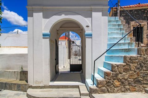 Mesanagros: The entrance of a local church and stone built stairs.