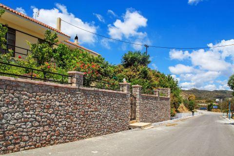 Mesanagros: Stone built walls and lush vegetation.