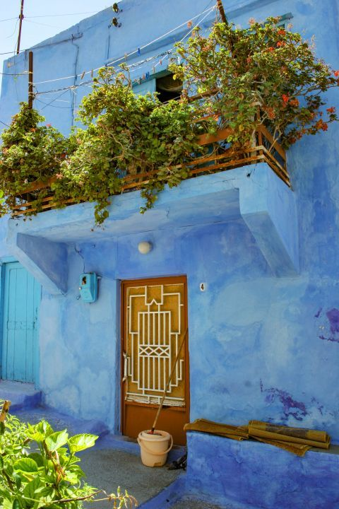 Paradisi Village: An impressive, neoclassical house, painted in light blue.