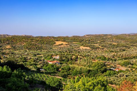 Salakos: Panoramic view of hills and green fields.