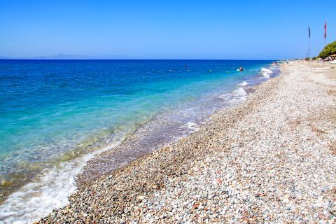 Theologos Beach: Soft pebbles and azure waters.