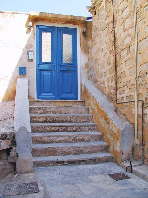 Ermoupolis: A blue-colored door in Ermoupolis.