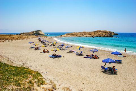 Lefkos: Some umbrellas and sun loungers on Lefkos beach.