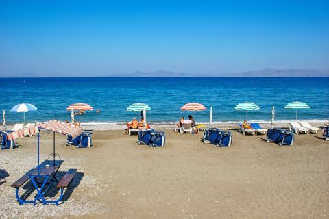 Ialissos: Relaxing moments by the sea on Ialyssos beach.