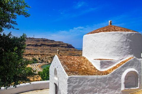 Lindos: Whitewashed chapel, overlookingthe magnificent landscape.