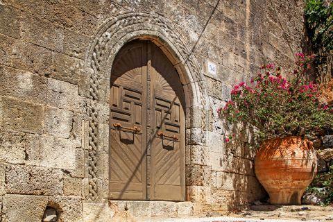 Lindos: Impressive gates and a lovely flower pot.