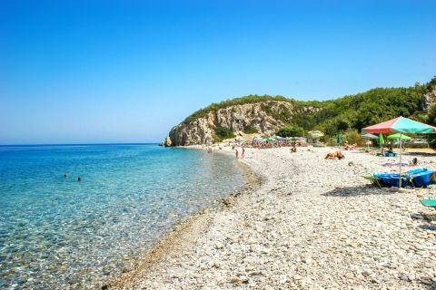 Tsabou: Pebbled beach with crystal clear waters.