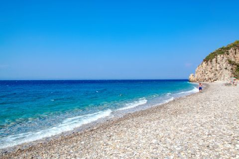 Tsabou: Blue waters and white pebbled.