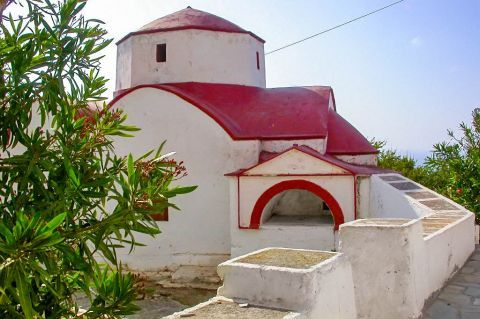 Mesochori: A whitewashed chapel with red colored details.