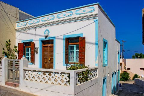 Arkassa: A picturesque, whitewashed house with colorful details.