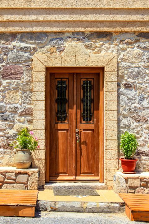 Kefalos: A stone built house with a wooden door.