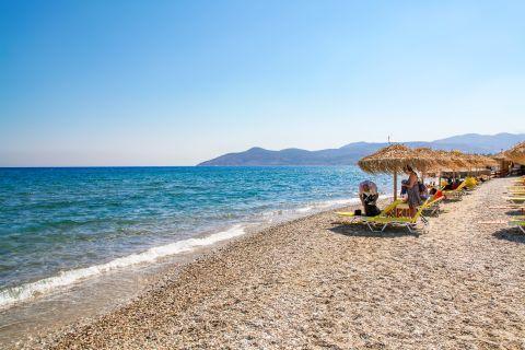 Potokaki: Some umbrellas and sun loungers by the sea.