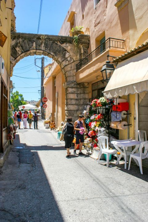 Town: The Big Door (Porta Guora) and the local market close to it.