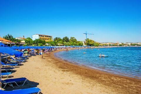 Faliraki: Sandy beach with blue waters. Faliraki beach.